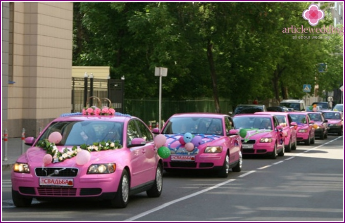 Decoration of a wedding procession with pink cars