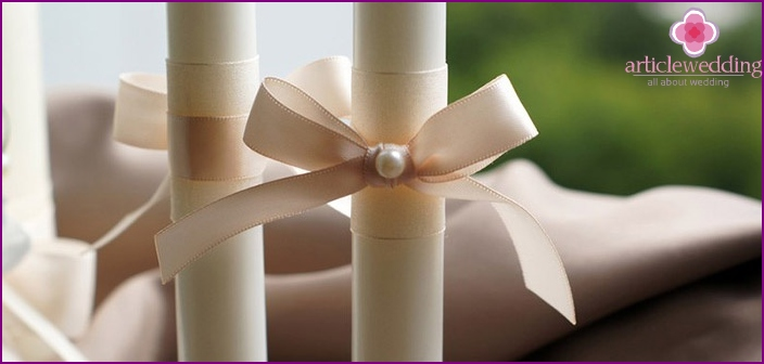 Wedding candles - a symbolic decoration of the celebration