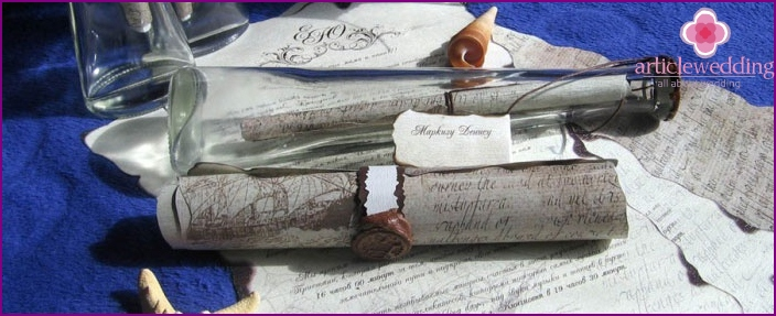 Wedding invitation in a scroll with nautical motifs