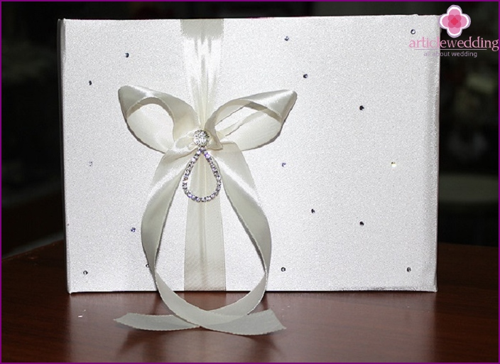 Wishes book decoration with satin ribbon