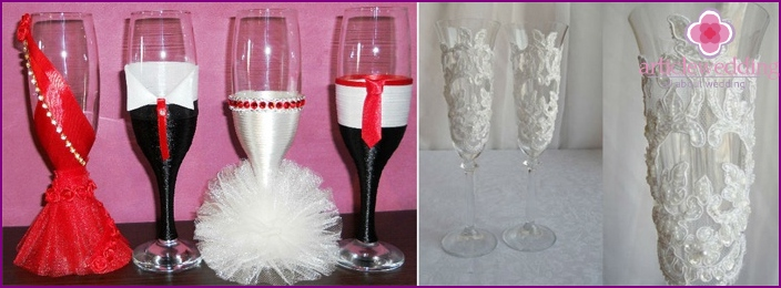 Wedding glasses decorated with satin ribbons and lace