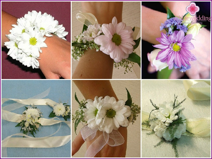 Accessory of their chrysanthemums on the hand of the bride's girlfriend