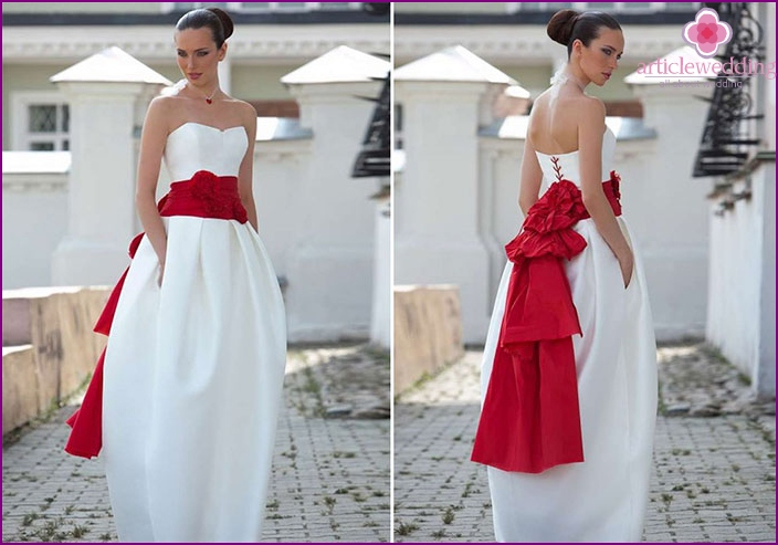 Red bow on a wedding dress