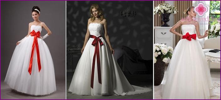 Scarlet ribbon on a lush wedding decoration