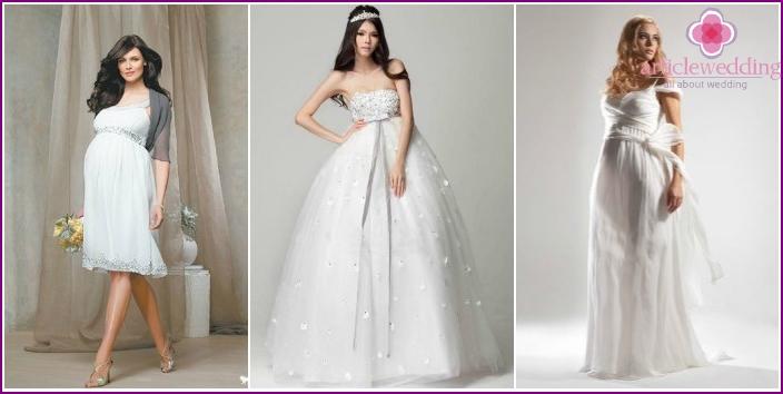Photos of pregnant brides in lush wedding dresses