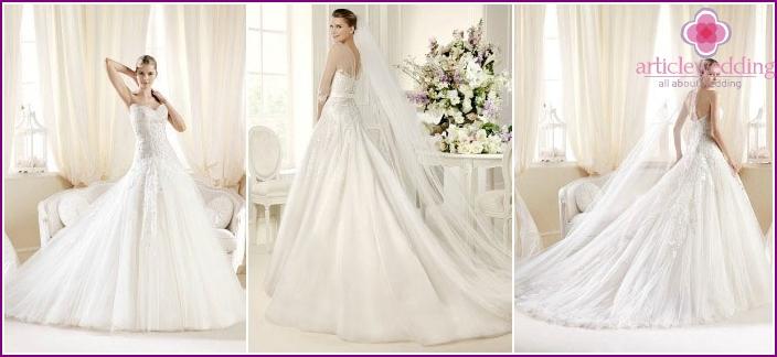 Voluminous wedding dress with a train
