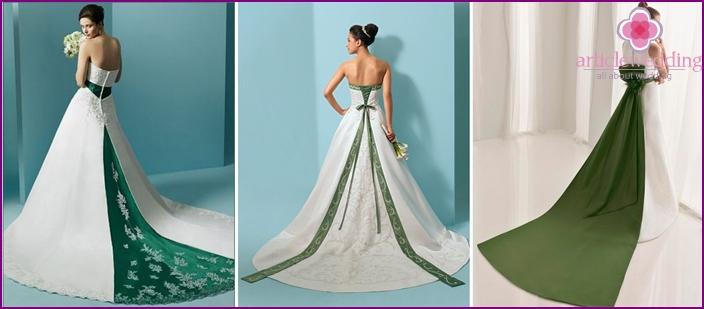 Luxuriöse weiße Outfits mit einem kontrastierenden grünen Zug