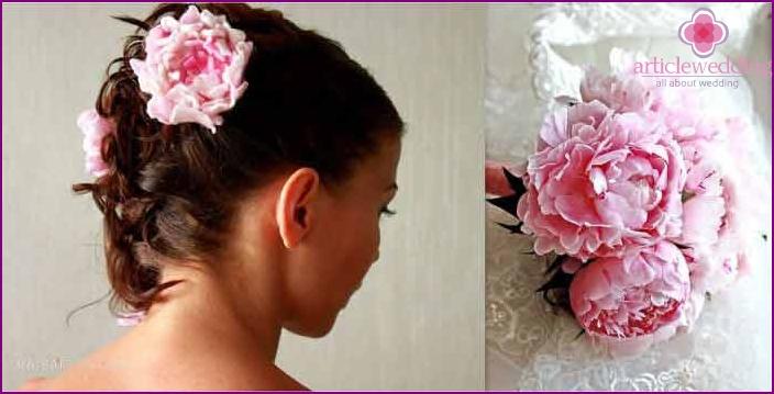 Seasonal flowers in bride hair styling