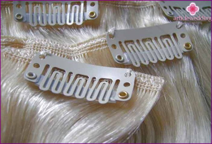 False locks on hairpins in a wedding hairstyle