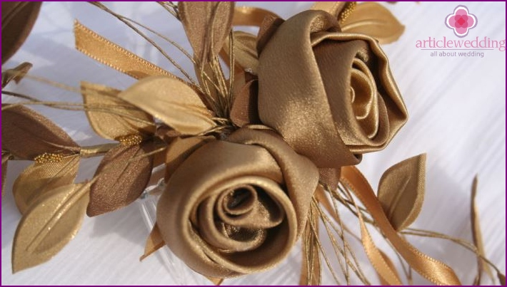 The image of the bride and groom: a floral wreath with satin ribbons
