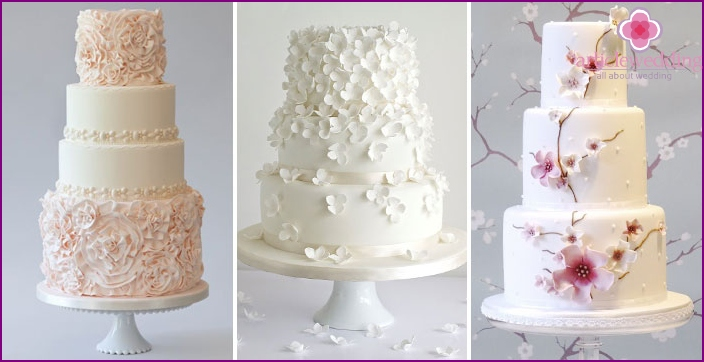 Layered cakes with a cascade of flowers