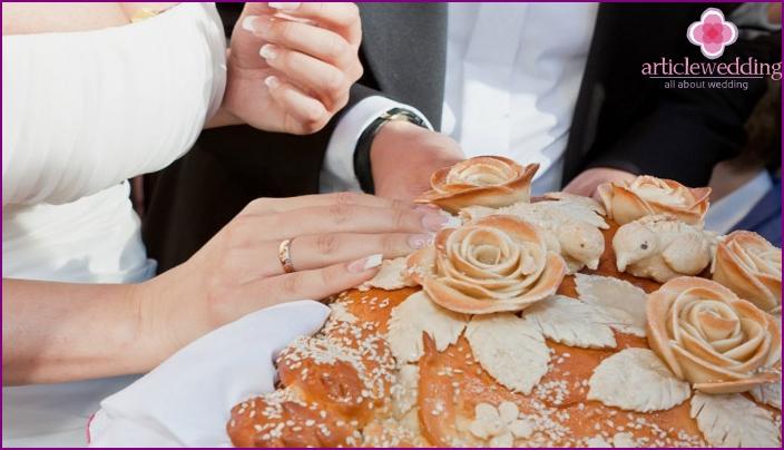 Newlyweds and wedding loaf
